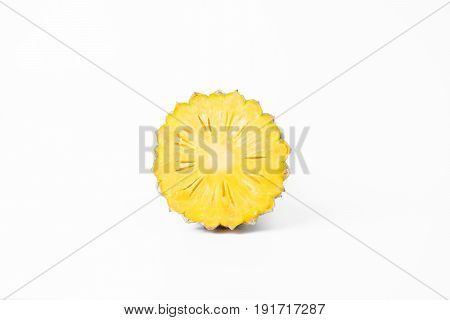 Round Pineapple Slice With Skin Isolated On White From Above.