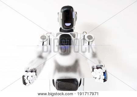Virtual reality. Pleasant serious cyborg is using transparent screen with concentration. Isolated background