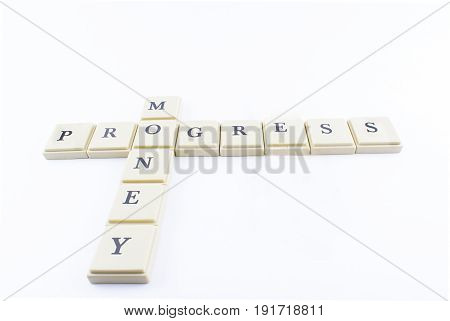 Progress and money written with crossword form on a white background.