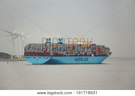 ROTTERDAM, THE NETHERLANDS -  SEPTEMBER 22, 2015: Maersk Triple E class container ship leving the Port of Rotterdam. It's one of the largest container ships, 400m long, 18000 TEU