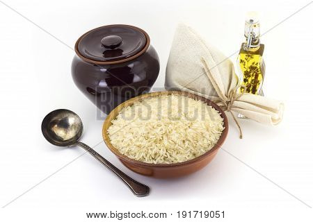 The Composition Of Steamed Rice Groats In A Clay Pial Next To A Clay Pot And A Copper Spoon,