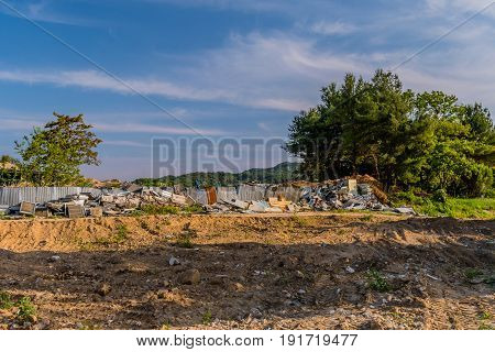 Debris from homes in the countryside that have been torn down to make room for development.