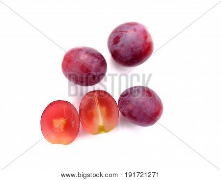Red grape sliced in a half isolated on a white background.