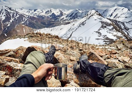 Man With Cup In The Mountain