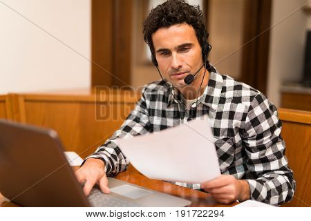 Man teleworking at home