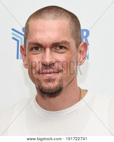 LOS ANGELES - JUN 03:  Steve Howey arrives for the Ante Up of Cancer on June 3, 2017 in Beverly Hills, CA