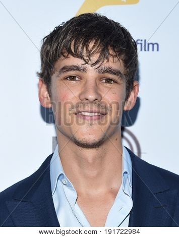 LOS ANGELES - JUN 01:  Brenton Thwaites arrives for the 9th Annual Heath Ledger Scholarship Dinner on June 1, 2017 in West Hollywood, CA