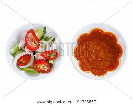 Sweet peanut sauce and sour pickles sauce for pork satay Thai food isolated on white background top view.