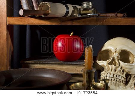 Gothic still life with a skull and an apple