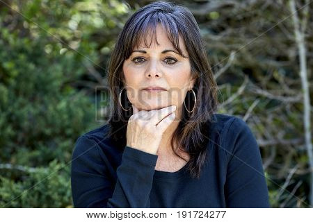 Middle Aged Woman Gazing Out In Thought