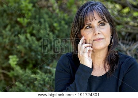 Middle Aged Woman Looking Up In Contemplation