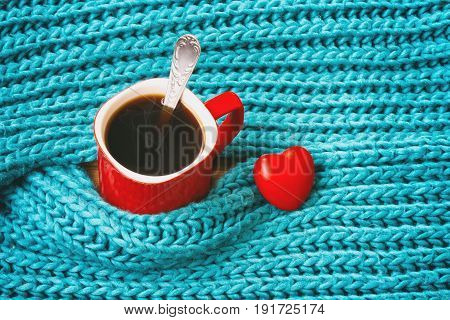 Turquoise knitted woolen scarf red mug with coffee heart valentine day theme