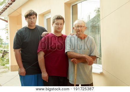 three generations, grandfather, father and son Father, son and grandson on veranda poster