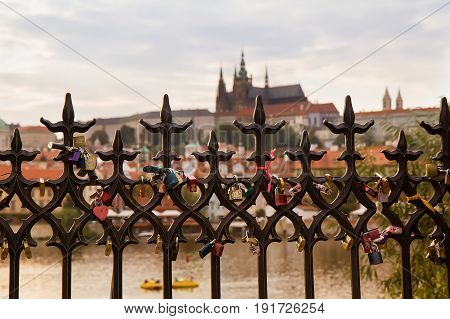 Prague - September 21 2016: fence with love locks and St. Vitus in background.