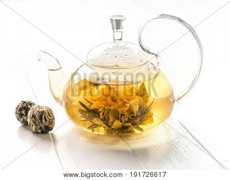 Fully brewed blossoming tea, chinese rare and delicious kind of tea in a pot