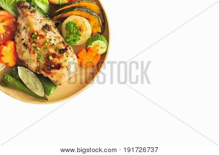 Homemade chicken breast barbecue served with grilled vegetables with isolated background. Delicious chicken barbecue and grilled vegetables for lunch or dinner. Roasted chicken breast steak. Chicken or pork steak in isolated background.