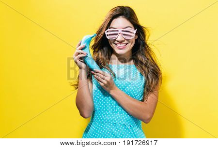 Happy Young Woman Holding A Colored Banana