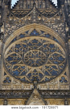 Close up of Rose window in historical St. Vitus cathedral. Architecture detail.
