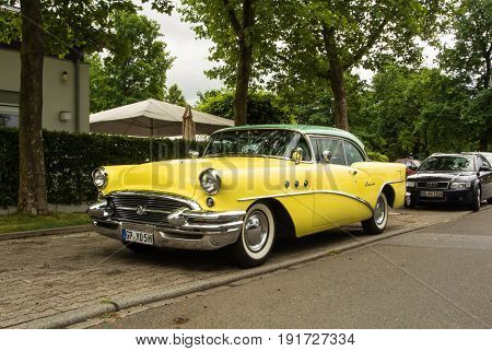 Walldorf, Germany - June 4, 2017: 1955 Buick Special Of Lemon Yellow And Mint Color At The Street Of