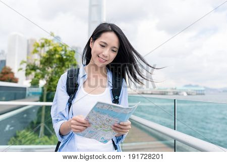 Woman use of city map in Hong Kong