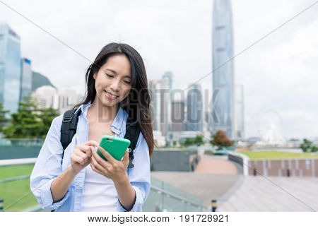 Woman use of cellphone in Hong Kong urban city