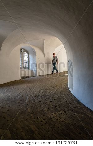 Copenhagen Denmark - August 11 2016. The Rundetaarn is a tower located in central Copenhagen it was built as an astronomical observatory. It is most noted for its equestrian staircase a helical corridor and for the expansive views.