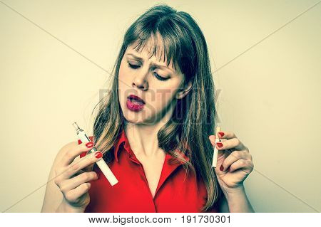 Woman With Tobacco Cigarette And Electronic Cigarette