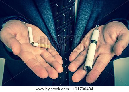 Businessman offers a choice between tobacco cigarette and electronic cigarette - retro style