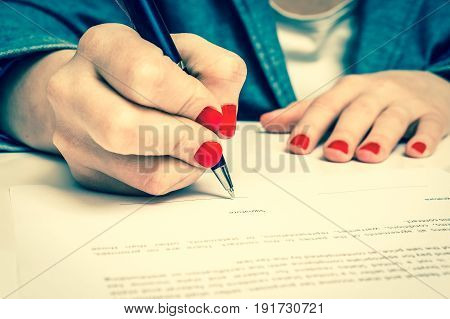 Woman With Ballpoint Pen Signing Contract Document