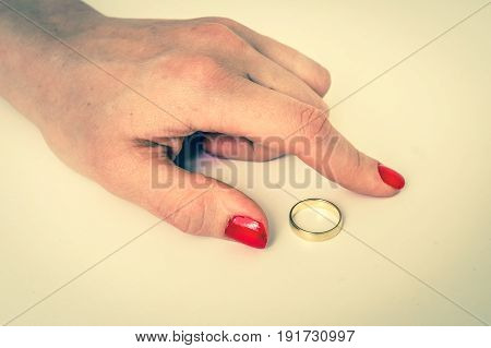 Hand of woman with wedding ring - divorce concept - retro style