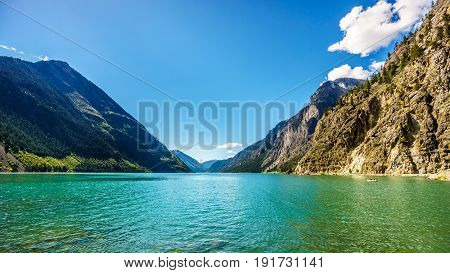 The clean green water of Seton Lake on the foot of Mount McLean near Lillooet. Seton Lake is located along Highway 99, the Duffey Lake Road, between Pemberton and Lillooet in southern British Columbia