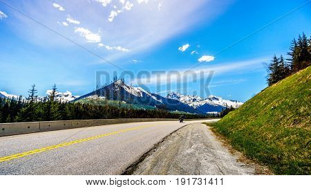 Motor Bikes navigating the curves of Highway 99, also called The Duffey Lake Road, as it winds its way through the Coast Mountain Range between Pemberton and Lillooet in southern British Columbia