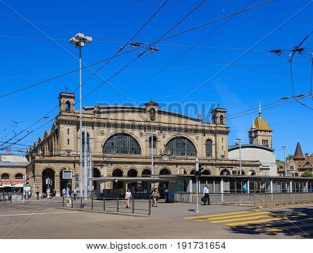 Zurich, Switzerland - 18 June, 2017: building of the Zurich main railway station, tram stop and people in front of it. Zurich main railway station is the largest railway station in Switzerland and one of the busiest railway stations in the world.