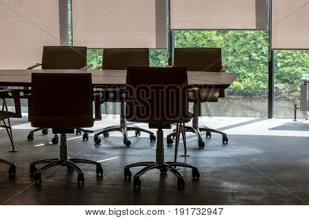 office interior fragment with conference  table and armchairs against   panoramic window  background
