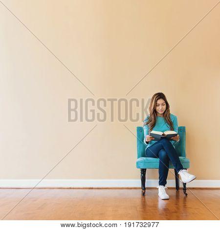 Young Latina Woman Reading A Book