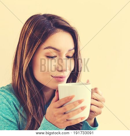 Young Latina Woman Drinking Coffee