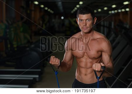 Athletic Man Training In Fitness Club, Front View