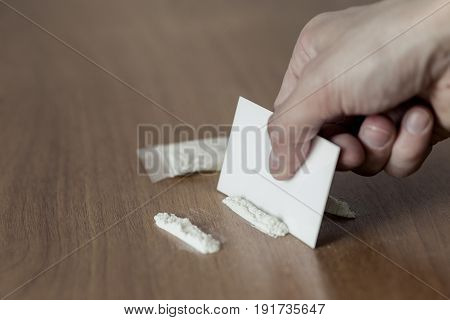 Plastic Packet, Lines And Pile Of Cocaine On Wooden Table.