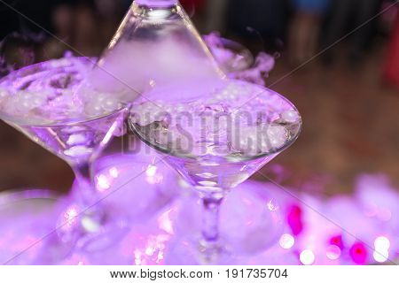 Champagne Slide. Pyramid Or Fountain Made Of Champagne Glasses With Cherry And Steam From Dry Ice