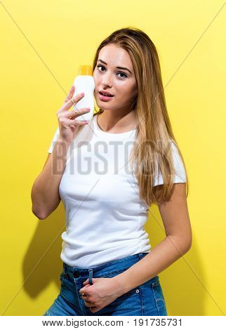 Young Woman A Bottle Of Sunblock