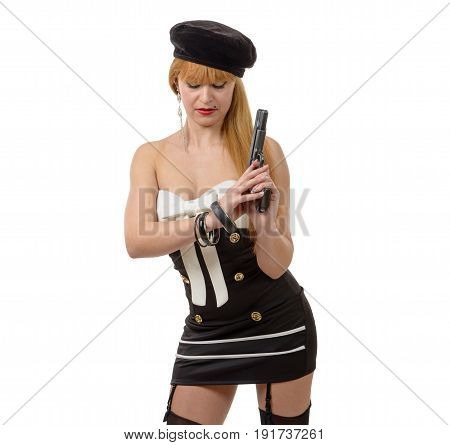 an attractive young sexy woman with a gun