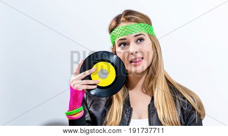 Woman With A Vinyl Record In 1980's Fashion