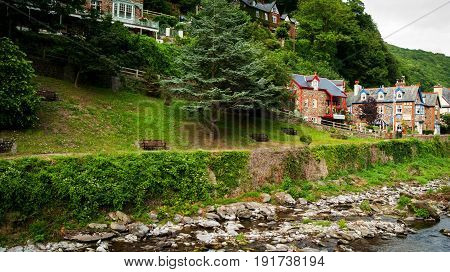 A row of houses offering bed and breakfast accommodation alongside the East Lyn River in Lynmouth in North Devon England UK