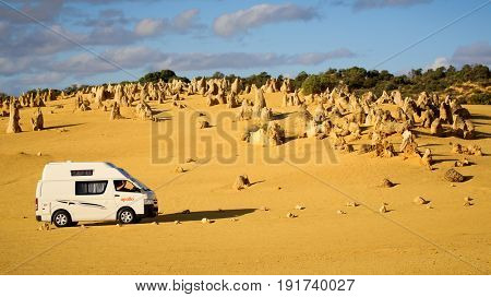 Numbung National Park, Western Australia MAY 20 2017: Campervan drives through The Pinnacles Desert, a major tourist attraction in Western Australia