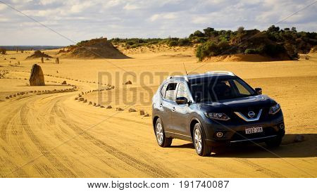 Numbung National Park, Western Australia MAY 20 2017: Car in The Pinnacles Desert, a major tourist attraction in Western Australia