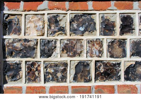 three rows of lava-bricks between two rows of clay bricks