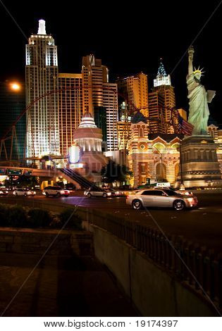 LAS VEGAS - MAY 1: Life continues at night. Illumination of New York Hotel & Casino on May 1, 2007 in Las Vegas, Nevada. The hotel skyline architecture simulates the real New York City skyline
