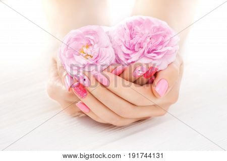 Pink Manicure With Tea Rose Flowers. Spa