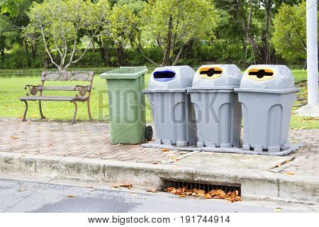 4 bins in the park with steel long chair