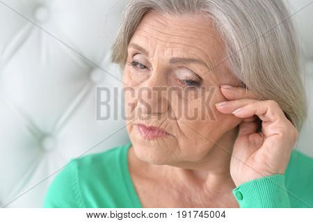 Portrait of sad senior woman, close up